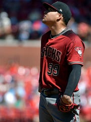 Jul 30, 2017; St. Louis, MO, USA; Arizona Diamondbacks starting pitcher Taijuan Walker (99) reacts after giving up a one run sacrifice fly to St. Louis Cardinals left fielder Jose Martinez (not pictured) during the sixth inning at Busch Stadium. Mandatory Credit: Jeff Curry-USA TODAY Sports