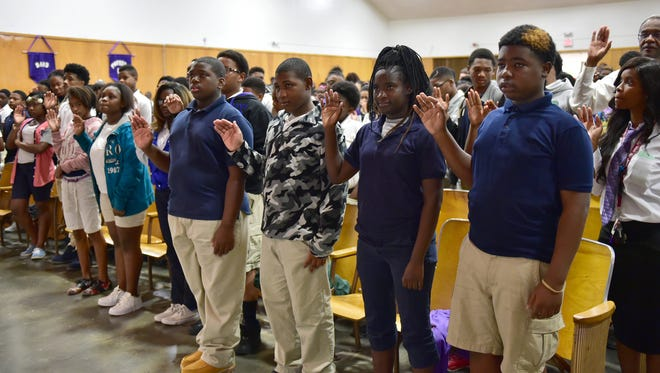 Whitten Middle School students listen to Hinds County Circuit Judge Tommie Green while reciting the student Pledge Against Gun Violence Wednesday during a Day of National Concern program in south Jackson. Gregory Davis, U. S. attorney for the Southern District of Mississippi, Jackson Police Chief Lee Vance, Hinds County District Attorney Robert Shuler Smith and other officials participated in the Day of Concern program, which emphasizes the role that young people themselves can play in helping to stem violence.