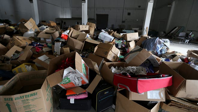 Open boxes of items are piled together at the Salvation Army warehouse on Thursday, Jan. 7, 2016, after employees tried to clean up following a robbery at the warehouse discovered Monday.