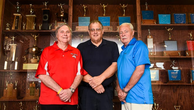 Rick Haver, left, Bob New, center, and Art Clouse were instrumental in finding and building a new home at the Knights of Columbus for the athletic trophies earned at Marion Catholic.