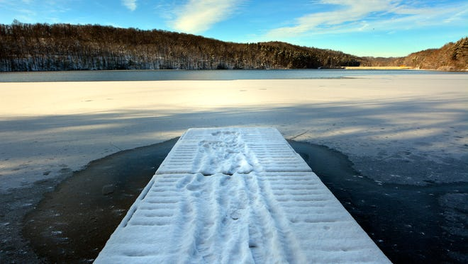 A thin coat of ice and light snow make Lake Williams postcard picture perfect, Friday, January 6, 2017. John A. Pavoncello photo
