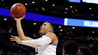 Villanova Wildcats guard Jalen Brunson (1) attempts a layup against the West Virginia Mountaineers during the first half of a game in the semifinals of the East regional of the 2018 NCAA Tournament at the TD Garden.
