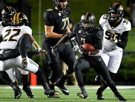 Vanderbilt running back Ralph Webb (7) advances against