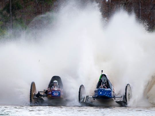 Eddie Chesser and Tyler Johns race side by side in the final race during the Swamp Buggy Races on Saturday, March 25, 2017, at Florida Sports Park in East Naples. Chesser pulled forward to finish in 52.72 second in his buggy, The Rapture, and win.