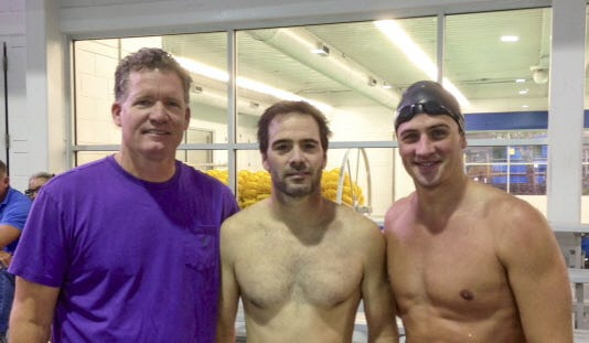 SwimMAC Carolina coach David Marsh, left, poses for a photo with NASCAR driver Jimmie Johnson, center, and Olympic swimmer Ryan Lochte on Thursday in Charlotte, N.C. Lochte has moved to Charlotte to train for the 2016 Olympics in Rio de Janeiro.
