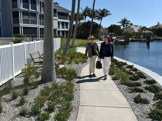 Judi Honiss (left), landscape chairman for The Pointes in The Moorings community, and Robin Pelensky, of Surlaterre Landscape Architecture, walk through their recently redesigned landscaping along the grounds of The Pointes along the Indian River Lagoon on Thursday, March 22, 2018, in Indian River County.