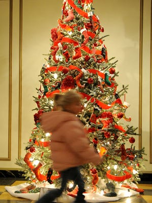 Alexandria Miles, 5, of Galion, speeds around Kingwood Hall in 2013, looking at decorations.