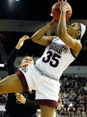 Mississippi State forward Victoria Vivians (35) attempts an off balanced shot at the basket during the first half of a first-round game against Troy in the women's NCAA college basketball tournament in Starkville.