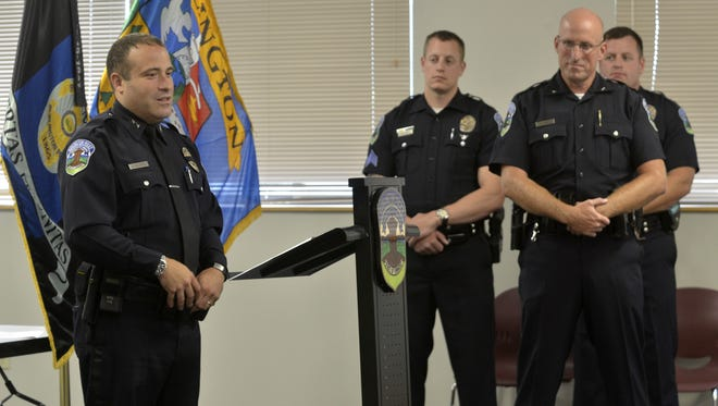 Chief Brandon del Pozo, left, speaks at a swearing-in and promotion ceremony Thursday at the Burlington Police Department. Sgt. Ric Volp, center, Deputy Chief Shawn Burke and Lt. Jonathan Young who received promotions all look on.