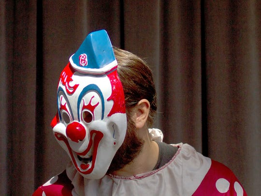 A file photo shows Cary Longchamps, a volunteer at the Baker Museum, dressed as a clown for community day at Artis-Naples on Sunday, Oct. 26, 2014. The clown outfit resembles the one worn by Wrinkles the Clown, whom Longchamps has been trying to raise money to make a documentary about. (Samuel Wilson/Staff)