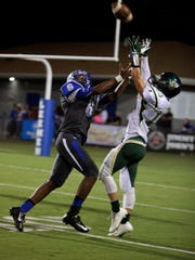Wilson Memorial's Michael Via, right, intercepts a