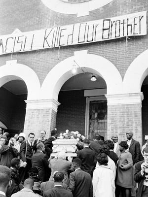 The casket bearing the body of Jimmie Lee Jackson is carried into a church in Selma, Alabama for funeral services in this March 3, 1965 file photo. Jackson, a 26-year-old laborer, was fatally wounded during an outbreak of racial violence during a demonstration at nearby Marion, Ala. The trooper who shot Jackson, James Bonard Fowler, said Monday May 7, 2007, that he expects to be indicted by a grand jury to review the shooting.