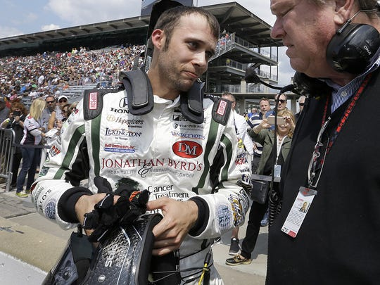 IndyCar driver Bryan Clauson (88) talks with team owner Dale Coyne following his qualifying run for the 100th running of the Indianapolis 500 on Saturday morning, May 21, 2016,   at   Indianapolis Motor Speedway.