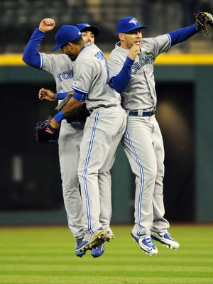Blue Jays outfielders, from left, Danny Valencia, Kevin Pillar Dalton Pompey celebrate their 5-1 win.