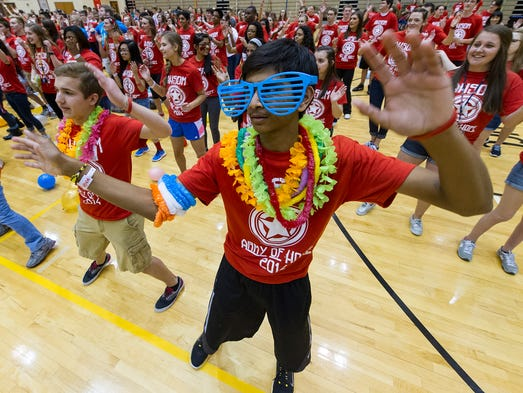 Rushi Patel, 15, begins learning the morale dance that the crowd will be performing throughout the evening. The Avon High School Riley Dance Marathon was held Saturday, April 19, 2014, benefitting Riley Hospital for Kids.