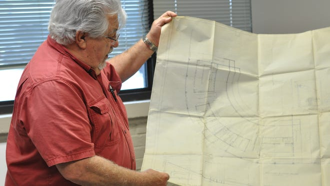 Joe Brocato Jr. holds a blueprint of Bringhurst Field in Alexandria.
