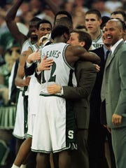 Mateen Cleaves #12 of Michigan State is congratulated