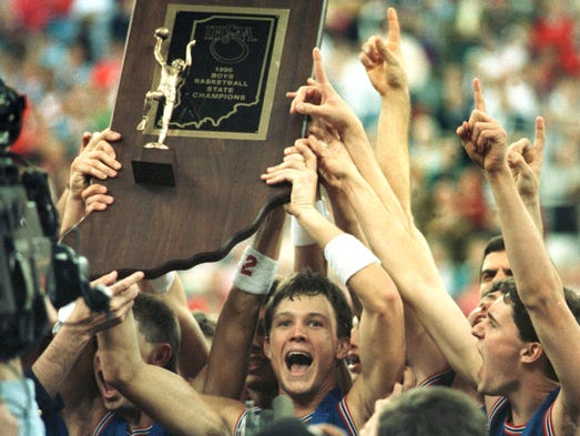 March 1990, Damon Bailey holds up the boys basketball