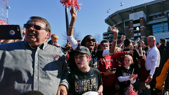 Alabama fans scream towards Alabama coach Nick Saban during the NCAA college football national championship parade, Saturday, Jan. 20, 2018, in Tuscaloosa, Ala. Alabama won the national championship game against Georgia 26-23 in overtime. (AP Photo/Brynn Anderson)