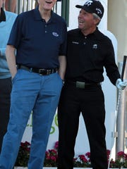 Former President Bill Clinton and golf legend Gary Player chat before the start of the first round of the 2014 Humana Challenge at PGA West in La Quinta on Jan. 16, 2014.
