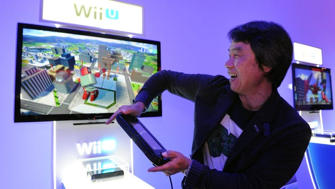 Nintendo game designer Shigeru Miyamoto plays 'Project Giant Robot' during an event at the Electronic Entertainment Expo in Los Angeles.