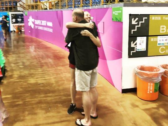 Purdue swimmer Kaersten Meitz greets her coach, John