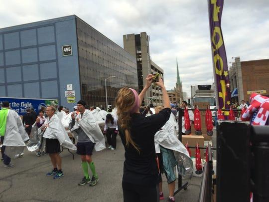 Hilary Marusak struggles with a selfie after breezing through the international half marathon in 1:44:11.