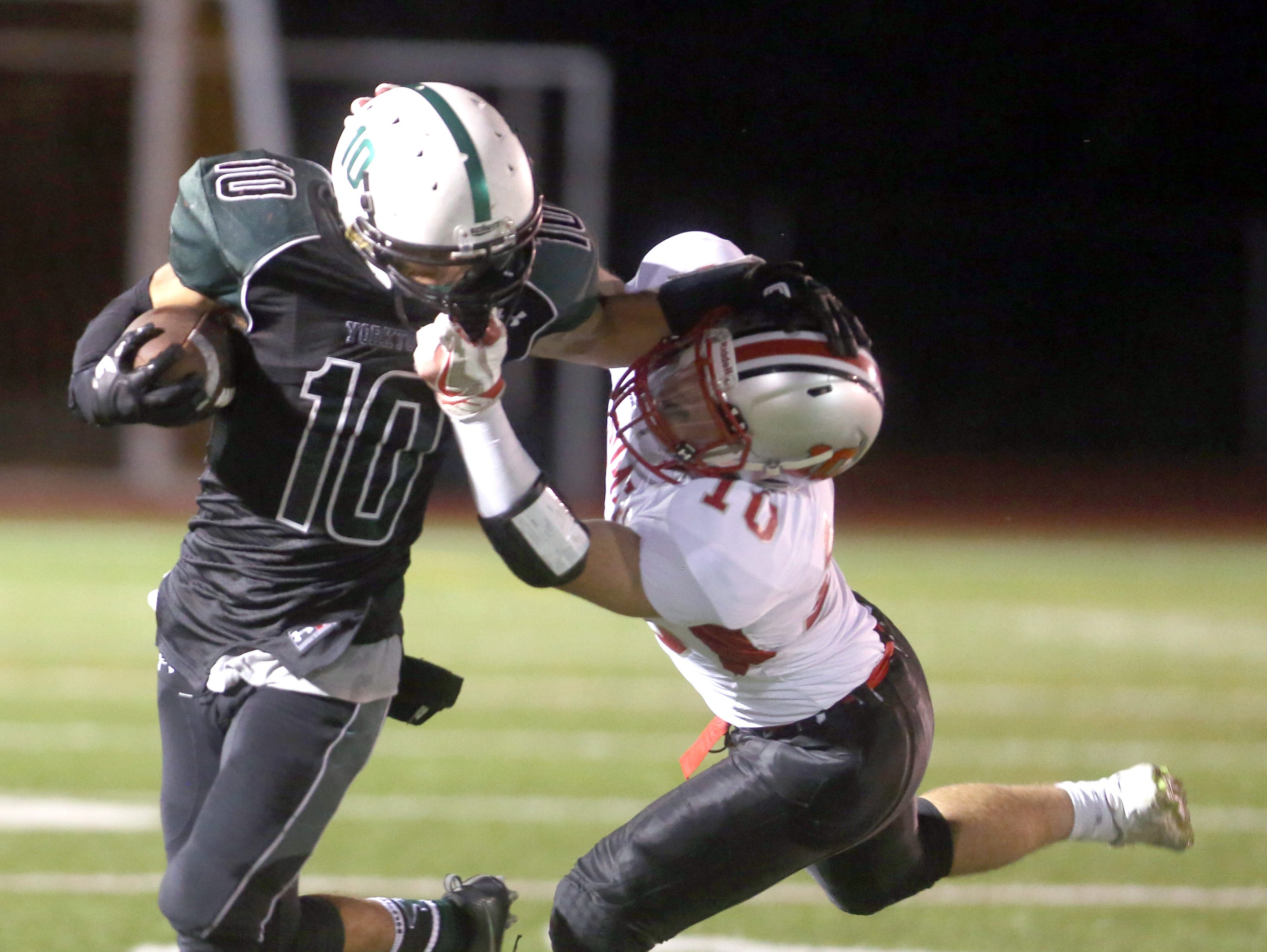 Cameron Pepe of Somers got called for a facemask penalty while trying to bring down Yorktown's Dominick Cioffi during Friday night's game at Yorktown High School.