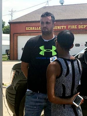 BrIan Pyle, owner of Pyle Transportation Inc., the Iowa trucking company linked to the deadly case of immigrant smuggling in Texas, is interviewed by a television reporter Monday, July 24, 2017, in Schaller, Iowa. The company owned the truck and employed the driver who was found outside a San Antonio Wal-Mart transporting immigrants stuffed inside the trailer. Pyle denied any knowledge of the smuggling operation, saying he had reached a deal to sell the truck to a person in Mexico in May. (AP Photo/Scott McFetridge)