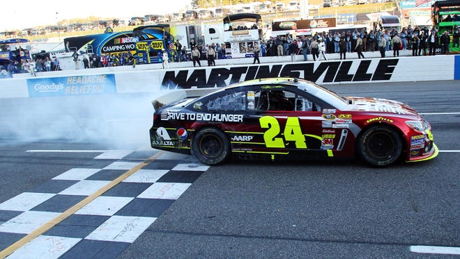 Jeff Gordon (24) does a burnout after winning Sunday's Goody's Fast Relief 500 at Martinsville Speedway.