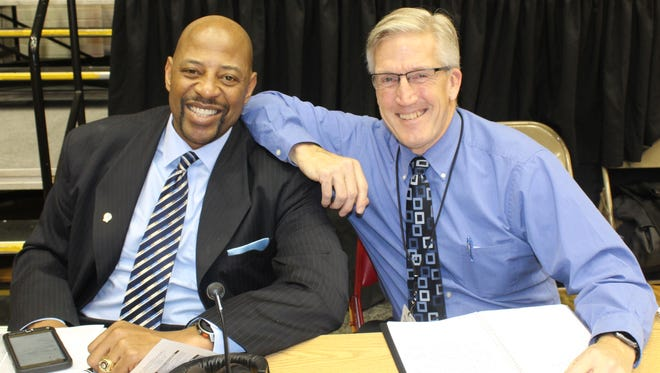 Farmington's Earl Cureton (left) and Bloomfield Hills Cranbrook graduate Dan Dickerson keep busy these days broadcasting UDM men's basketball games.