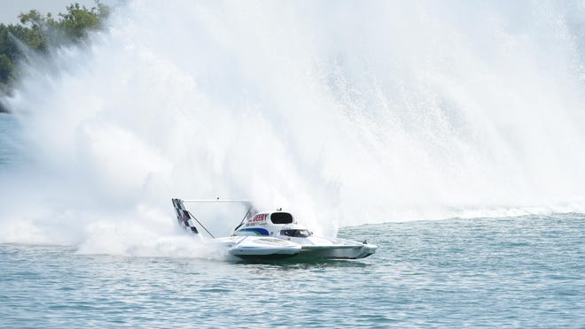 The Al Deeby Dodge unlimited hydroplane entry pushes its turbine-powered boat in the Detroit Hydrofest along the Detroit River on Friday.