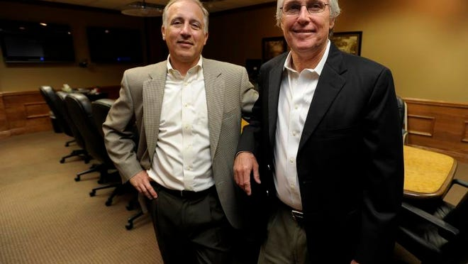 """CEO Rich D'Amaro and William """"Kip"""" Schumacher, founder and executive chairman, pose for photographs at the Schumacher Group in Lafayette, LA, Tuesday, April 8, 2014. Paul Kieu, The Advertiser"""