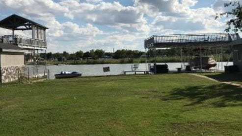 This photograph shows the view of the lake from the backyard of Babiash family's home on Lake Nasworthy, as presented to the San Angelo City Council for consideration. The couple was granted an exemption to allow the property to be used as a short-term rental.
