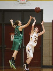 Salisbury's Julia McLaughlin goes up for a loose ball against York's Jess Selby.