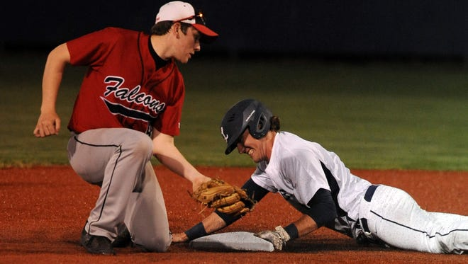 Lancaster's Avery Baker slides safely into second base under the tag of Fairfield Union second baseman James Troup Thursday night at Beavers Field.