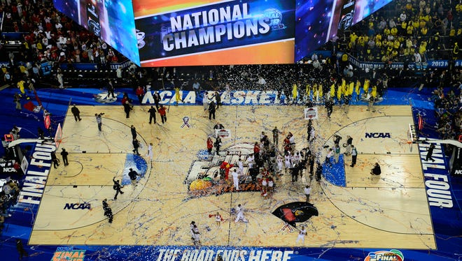 Louisville gathers on the floor at the Georgia Dome in April to celebrate its taking of the 2013 NCAA title. The road this season ends at AT&T Stadium in Arlington, Texas.