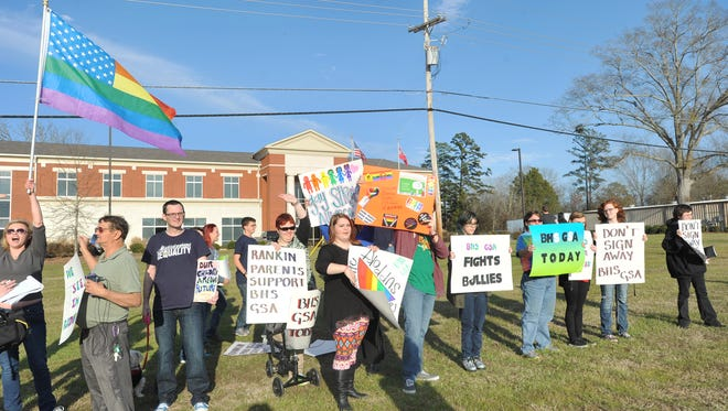 Supporters of the proposed gay-straight alliance protest Tuesday at the Rankin County School District offices along U.S. 80 in Brandon. The groups gathered to protest the Rankin County school board's decision to change its policy around school clubs in an attempt to prevent student from forming gay-straight alliances in their schools.