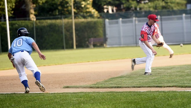 In a Legion baseball game last summer, Chambersburg's Kevin Carbaugh (10) decides whether to run from third base as Elijah Webster of Greencastle fields a ball.