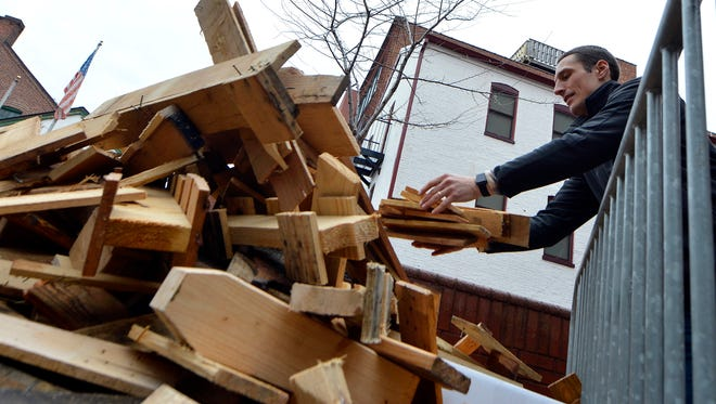 Adam Nugent, director of special events for the York Revolution, unloads firewood for this weekend's FestivICE event on Cherry Lane, Thursday, January 12, 2017. The event features live ice sculpting, music, fire pits and marshmallows, frozen turkey bowling and more from 9a.m.-3p.m. on Cherry Lane and N. Beaver St. John A. Pavoncello photo