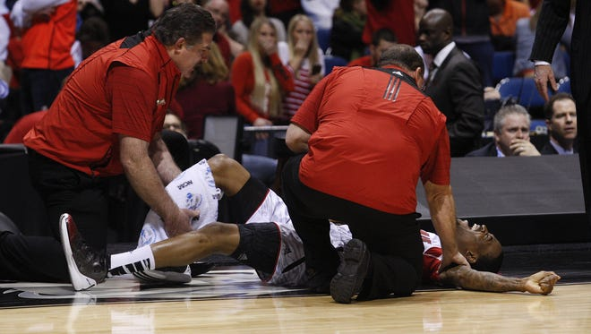 U of L's Kevin Ware grimmaces in pain after breaking his right leg against Duke in 2013.