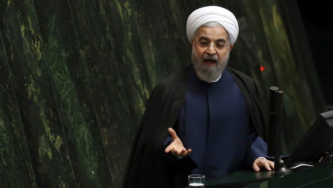 Iranian President Hassan Rouhani speaks to parliament in Tehran on Nov. 18, 2014.