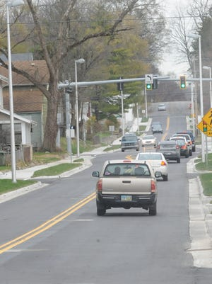 A reopened South E Street is busy with traffic Monday afternoon following completion of a construction project.