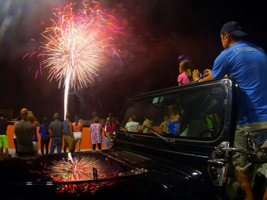 John Paluzzi video tapes the fireworks show Friday (7/4/14) at the Freedom Fest Block Party in downtown Fort Myers.
