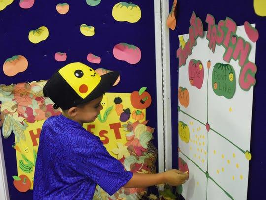 Logan Blum, 6, participates in a taste testing survey