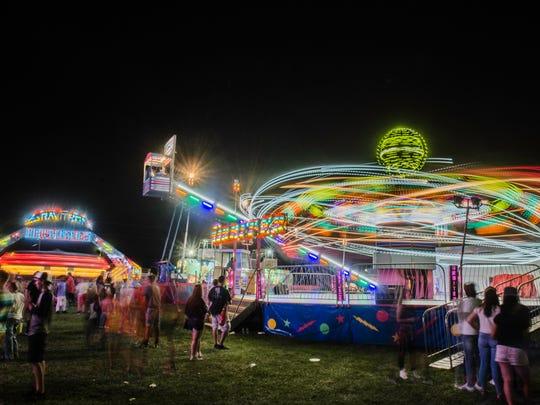 Fairgoers enjoy the 2017 Wayne County 4H Fair at the county's fairgrounds on Tuesday, June 21, 2017.