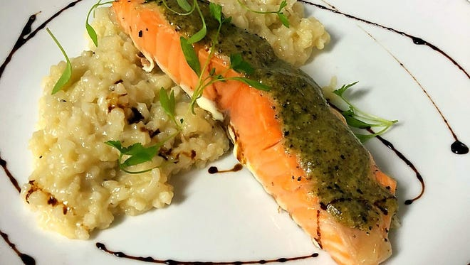 At C.C.'s Kitchen, salmon is accompanied by a mustard risotto, thyme and rosemary gremolata.