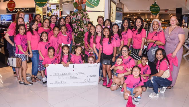 Students, parents, employees and families of B.P. Carbullido Elementary School are beaming with smiles after winning first place in their division in the T Galleria by DFS, Guam's Fifth Annual DFS Festival of Trees competition in Tumon on Saturday, Jan. 6, 2018. As part of the holiday celebration, the Galleria invited participants from the island's elementary schools and high schools to demonstrate their creative skills in decorating Christmas trees with student-designed ornaments. This year, 10 elementary schools and all six public high schools took part in the competition.