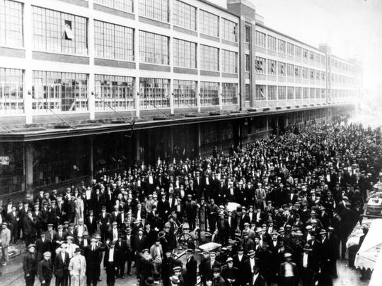 A crowd of applicants outside the Ford Motor Co. Highland Park Plant after the announcement of the $5 a day wage in January 1914.