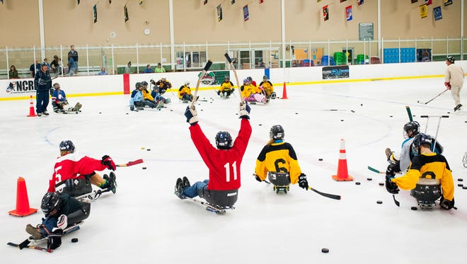 Dave Tropf reacts to winning a game during a fun sled hockey demo day hosted by the Florida Sled Hockey Association at the Skatium in Fort Myers, Fla., on Sunday, Sept. 18, 2016.
